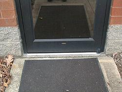Door with sweep seal installed & Door Sweeps | Door Seals | Door Insulation - Sealeze A Jason Company